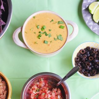 Healthier Build Your Own Nachos Bar {with Queso Dip + Refried Beans}