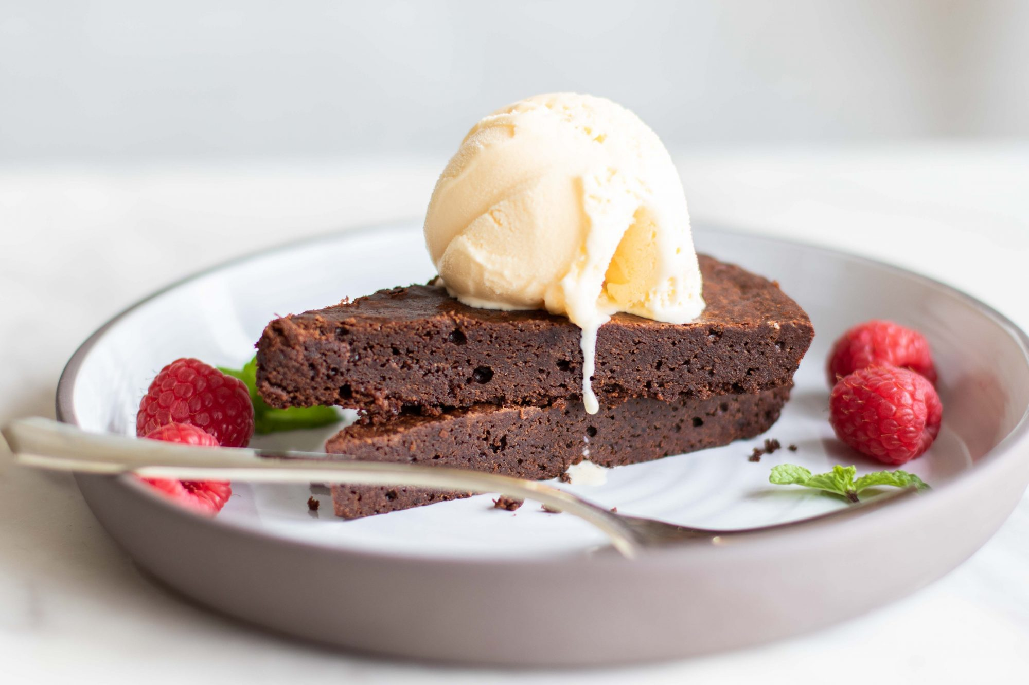 This Coconut Oil Skillet Brownie is featured in The Modern Cast Iron Cookbook