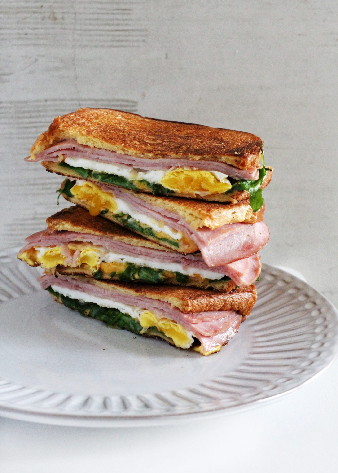 Grilled ham and cheese with a perfectly fried egg makes a delicious breakfast.
