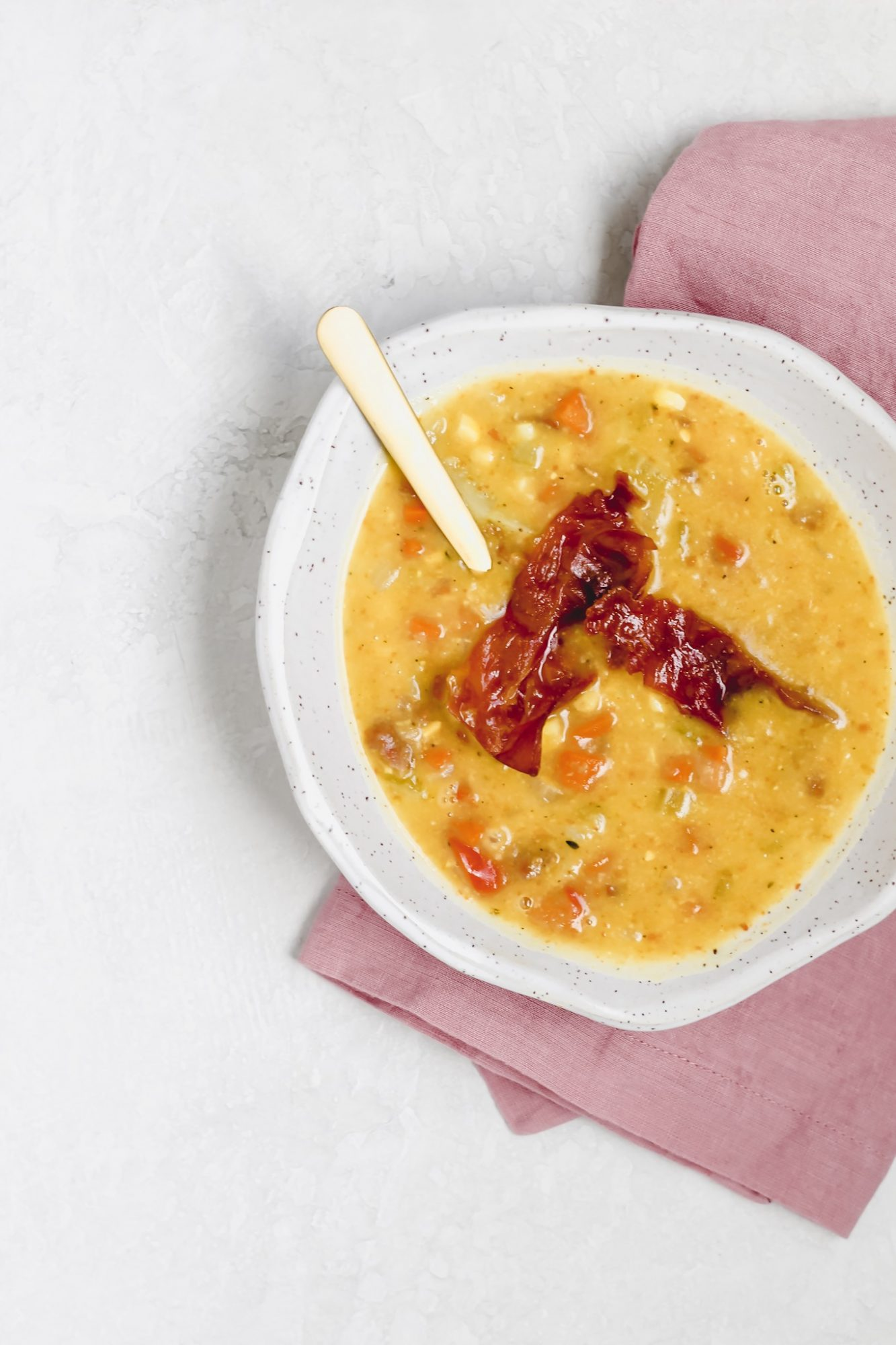 Potato corn chowder topped with crispy French ham