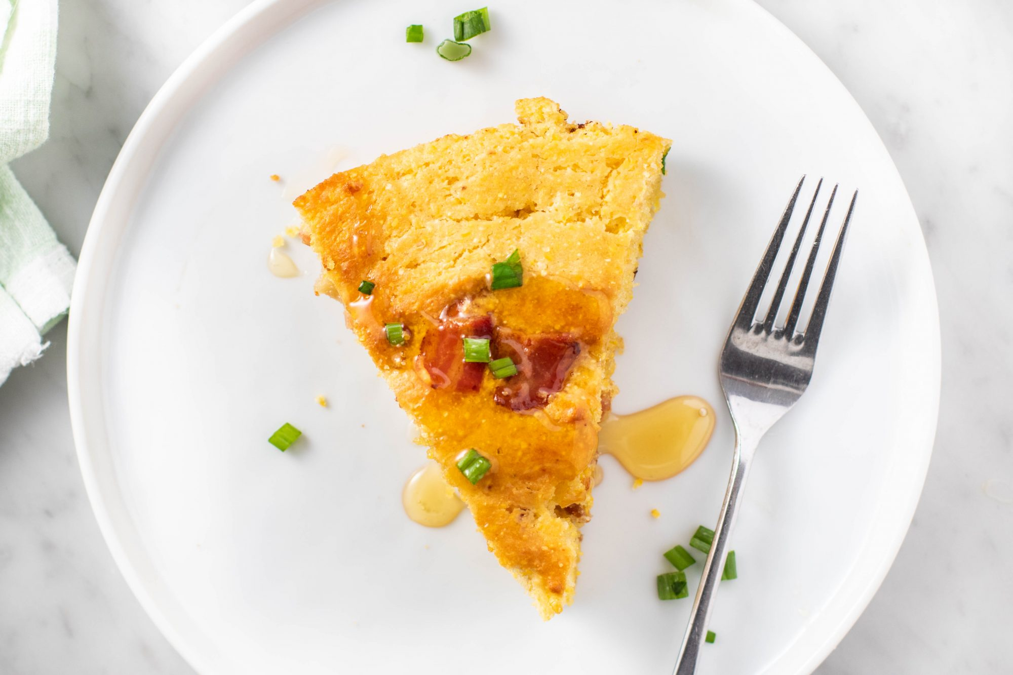 a slice of cornbread baked in a skillet